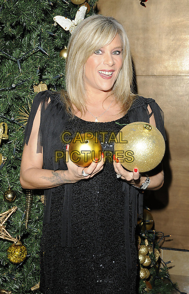 SAMANTHA FOX .Attending the ITV at the Movies Party, The May Fair Hotel, London, England, UK, December 2nd 2010..half length black dress tassels fringed sequined sequin holding baubles gold funny .CAP/CAN.©Can Nguyen/Capital Pictures.