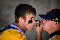 May 31, 2010; Grand Junction, CO, USA; Southern Nevada Coyotes catcher Bryce Harper (left) uses the reflection off a teammates sunglasses to apply grease beneath his eyes prior to the game against the Faulkner State Sun Chiefs during the Junior College World Series as Suplizio Field. Southern Nevada won the game 18-1. Mandatory Credit: Mark J. Rebilas-