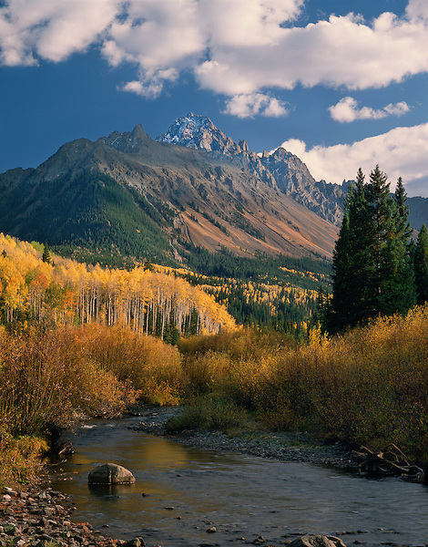 Mount Sneffels (14150 feet) and Dallas Creek with Aspen trees, Telluride, Colorado, USA John offers autumn photo tours throughout Colorado.