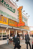 Visitors to Coney Island in New York on Saturday, March 26, 2016 stop at  Nathan's Famous restaurant. The iconic eatery was founded in 1916 has been in business 100 years. (© Richard B. Levine)