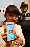 "January 11, 2017, Tokyo, Japan - A model displays the new smart phone for children ""miraie f"", produced by Kyocera as a part of Japan's telecom giant KDDI's new smart phone line up in Tokyo on Wednesday, January 11, 2017. KDDI announced the new student disscount rate service against low-cost MVNO smart phone service.   (Photo by Yoshio Tsunoda/AFLO) LWX -ytd-"