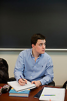 Group leader Aaron Pinet (junior) takes notes in the NASE402 Science in Environmental Policy course in Waltham, Massachusetts, USA.  The class involves an optional extra section that includes a trip to Washington, D.C., for these students to meet with policy makers and discuss the role of science in making government policy.