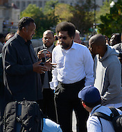 October 17, 2011  (Washington, DC)  Reverend Jesse L. Jackson (left) talks to Dr. Cornel West (center) and R&B singer Raheem DeVaughn (right) before a press conference in Washington.  West, DeVaughn and 15 others were arrested for protesting on the grounds of the US Supreme Court on October 16, 2011, the day of the MLK Memorial Dedication.    (Photo by Don Baxter/Media Images International)