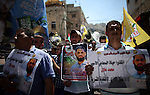 Protesters participate in a demonstration supporting the Palestinian prisoner in Israeli jails Mohammad Allan, during a protest in the West Bank city of Nablus, on August 14, 2015. The Israeli military prosecutor intends to request court permission on Saturday to force-feed hunger striking prisoner Mohammad Allan, the Palestinian minister of prisoner affairs, Issa Qaraqe announced on Friday. Allan, a lawyer from the occupied West Bank city of Nablus, has been on hunger strike for at least 60 days in protest of his detention without charge or trial since his arrest in November. Photo by Ahmad Talat