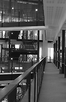 Interior corridors and hanging steel stairs of a Manchester research center.
