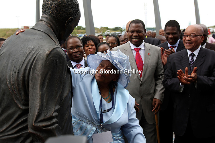 DURBAN - 8 March 2012 - Lulu Dube admires a statue of her father John Dube which was unveiled at the official opening of the Dube TradePort by President Jacob Zuma. .Dube was the founding president of the ruling African National Congress.  Looking on from left are transport minister Sbu Ndebele, KwaZulu-Natal Premier Zweli Mkhize (red tie), Artcs and Culture minister Paul Mashatile and Zuma..Picture: Giordano Stolley