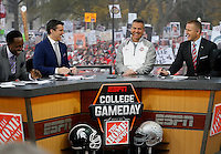 From left, Desmond Howard, Rece Davis, Urban Meyer and Kirk Herbstreit talk on the set of ESPN's College GameDay broadcast from the campus of Ohio State prior to the NCAA football game against the Michigan State Spartans in Columbus on Nov. 21, 2015. (Adam Cairns / The Columbus Dispatch)