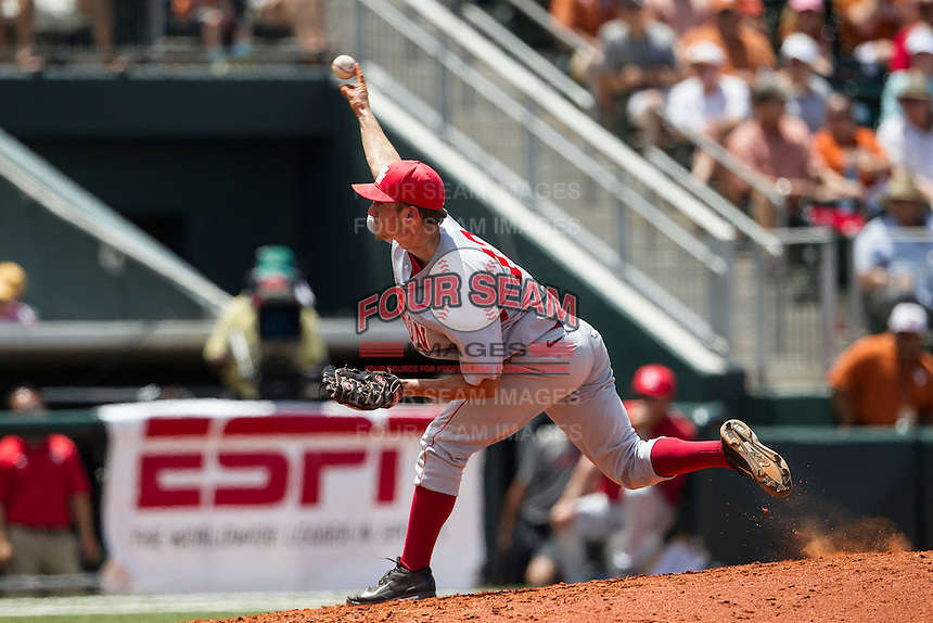 Houston Cougars pitcher Jared Robinson (12) delivers a pitch to the plate during the NCAA Super Regional baseball game against the Texas Longhorns on June 7, 2014 at UFCU Disch–Falk Field in Austin, Texas. The Longhorns are headed to the College World Series after they defeated the Cougars 4-0 in Game 2 of the NCAA Super Regional. (Andrew Woolley/Four Seam Images)