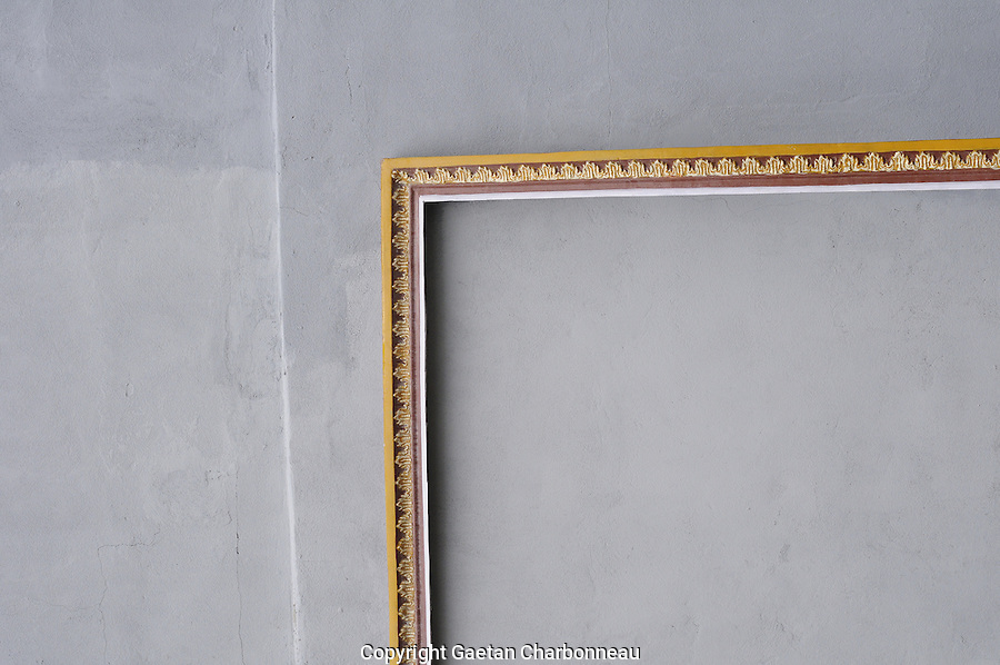 Empty luxury frame aginst a grey wall