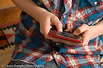 closeup of hands of teenage boy texting on cell telephone text messaging Caucasian horizontal