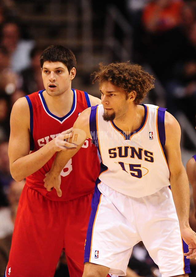 Dec. 28, 2011; Phoenix, AZ, USA; Phoenix Suns center Robin Lopez (right) and Philadelphia 76ers forward Nikola Vucevic at the US Airways Center. The 76ers defeated the Suns 103-83. Mandatory Credit: Mark J. Rebilas-USA TODAY Sports