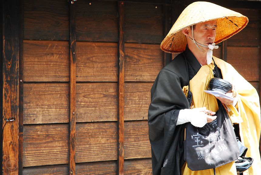 Following the path of the buddhas of old<br /> I beg my way from door to door<br /> -Ryokan<br /> <br /> A Buddhist monk begs for alms along a street below Kiyomizu Temple in Kyoto, Japan.<br /> <br /> (title translation Ryuichi Abe &amp; Peter Haskel)