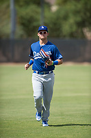 Los Angeles Dodgers left fielder Andy Pages (65) jogs off the field between innings of an Instructional League game against the Milwaukee Brewers at Maryvale Baseball Park on September 24, 2018 in Phoenix, Arizona. (Zachary Lucy/Four Seam Images)
