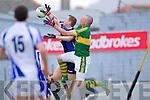 Kieran Donaghy tackles Waterford's keeper Stephen Enright last Saturday in Fitzgerald Stadium for the Munster GAA football championship
