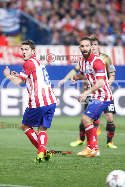 Atletico de Madrid´s Koke (L) and Arda Turan during 16th Champions League soccer match at Vicente Calderon stadium in Madrid, Spain. March 11, 2014. (ALTERPHOTOS/Victor Blanco)