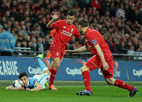 28.02.2016. Wembley Stadium, London, England. Capital One Cup Final. Manchester City versus Liverpool. Manchester City Midfielder Jesús Navas is brought down by Liverpool Midfielder Philippe Coutinho