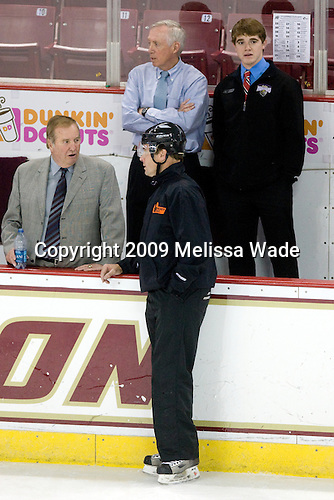 Jim Logue (BC - Assistant Coach), Jerry York (BC - Head Coach), Brian Billett (Junior Monarchs) - The Boston College Eagles defeated the Merrimack College Warriors 4-3 on Friday, October 30, 2009, at Conte Forum in Chestnut Hill, Massachusetts.