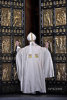 Pope Francis opens Holy Door at St Peter's basilica of the Jubilee Year of Mercy, December 8, 2015