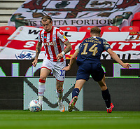 4th July 2020; Bet365 Stadium, Stoke, Staffordshire, England; English Championship Football, Stoke City versus Barnsley; James McClean of Stoke City under pressure from Kilian Ludewig of Barnsley