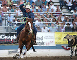 Ike Folsom competes in the team roping event at the Reno Rodeo in Reno, Nev., on Thursday, June 27, 2013.<br /> Photo by Cathleen Allison