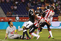 BARRANQUILLA - COLOMBIA -20 -04-2014: Martin Arzuaga (Cent.) y Luis Quiñonez (Der.), jugadores de Atletico Junior disputan el balón con Camilo Vargas (Izq.), Hector Urrego (2Izq.) y Francisco Meza (Der.) jugadores de Independiente Santa Fe durante partido entre Atletico Junior y Independiente Santa Fe por la fecha 18 por la Liga Postobon I 2014, jugado en el estadio Metropolitano Roberto Melendez de la ciudad de Barranquilla. Martin Arzuaga (C) and Luis Quiñonez (R), players Atletico Junior vie for the ball with Camilo Vargas (L), Hector Urrego (2L) and Francisco Meza (R) players of Independiente Santa Fe during a match between Atletico Junior and Independiente Santa Fe for the date 18th of the Liga Postobon I 2014 at the Metropolitano Roberto Melendez Stadium in Barranquilla city. Photo: VizzorImage  / Alfonso Cervantes / Str