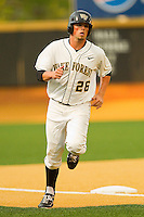 Charlie Morgan #26 of the Wake Forest Demon Deacons rounds third base after hitting a solo home run against the Florida State Seminoles at Wake Forest Baseball Park on March 24, 2012 in Winston-Salem, North Carolina.  The Seminoles defeated the Demon Deacons 3-2.  (Brian Westerholt/Four Seam Images)