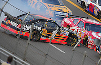 Oct 5, 2008; Talladega, AL, USA; NASCAR Sprint Cup Series driver Martin Truex Jr (1) crashes during the Amp Energy 500 at the Talladega Superspeedway. Mandatory Credit: Mark J. Rebilas-