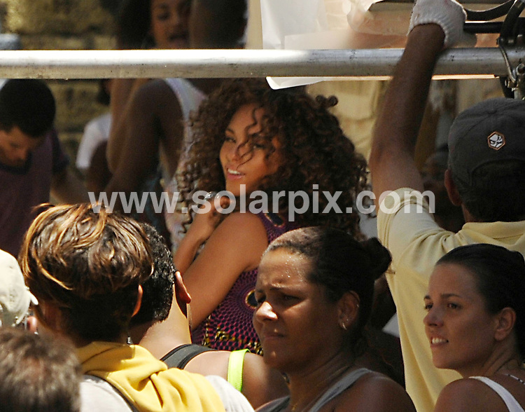 **ALL ROUND PICTURES FROM SOLARPIX.COM**.**SYNDICATION RIGHTS FOR UK AND SPAIN ONLY**.American singer Alicia Keys was seen at Conceicao slum, in central Rio, to shoot a scene for Beyonce Knowles music video - Put It in a Love Song - in which they sing a duo. Both singers as well Madonna are all staying at the same hotel, the Fasano, in Ipanema. Brazil. 9 February 2010..This pic: Alicia Keys..JOB REF: 10659 PRT        DATE: 09_02_2010.**MUST CREDIT SOLARPIX.COM OR DOUBLE FEE WILL BE CHARGED**.**MUST NOTIFY SOLARPIX OF ONLINE USAGE**.**CALL US ON: +34 952 811 768 or LOW RATE FROM UK 0844 617 7637**