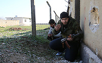 Photographer: Rick Findler/Borderline News..17.01.13 Abu Thahbet (a field commander of the FSA) order his men during incoming fire as they attempt to have a closer look at Minnagh Military Airport. They are hoping to plan an offensive attack to take the airport from Assad control outside of Aleppo