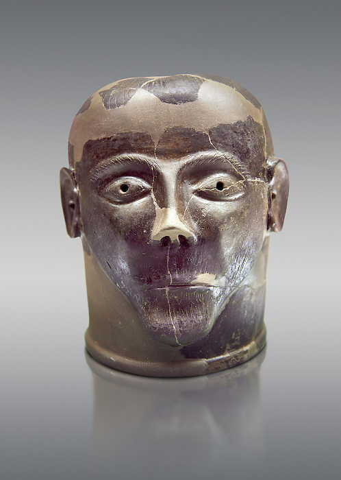 6th century B.C clay head made in Chiusi, inv 94619, National Archaeological Museum Florence, Italy , against grey