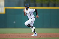 Eloy Jimenez (20) of the Charlotte Knights takes off for third base against the Rochester Red Wings at BB&T BallPark on May 14, 2019 in Charlotte, North Carolina. The Knights defeated the Red Wings 13-7. (Brian Westerholt/Four Seam Images)