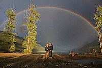 A kayaker paddles under a rainbow at Trout Lake, British Columbia on Tuesday May 28, 2013. THE CANADIAN PRESS/Jason Franson
