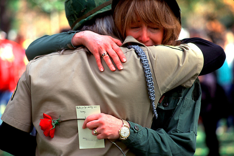 "Dedication of Vietnam Womens Memorial.November 1995, Washington DC.Former nurse Kendall Gardiner greets a fellow Vet. She holds in her hand a note which says ""Thank you for Saving our Country"""