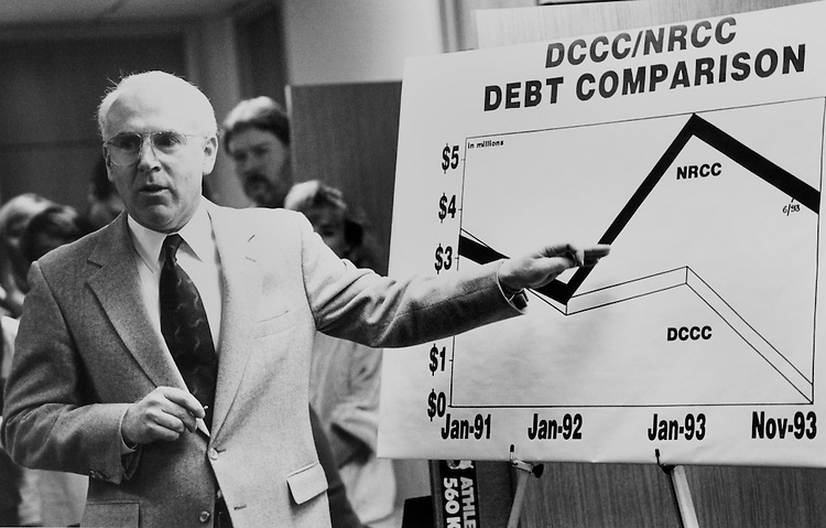 "Rep. Victor Herbert Fazio, D-Calif., House Democratic Caucus Vice Chairman, at Democratic Congressional Campaign Committee (DCCC) reception/press conference celebrating ""no debt"". Chart shows comparison between the DCCC and the National Republican Congressional Committee (NRCC). December 6, 1993 (Photo by Laura Patterson/CQ Roll Call)"
