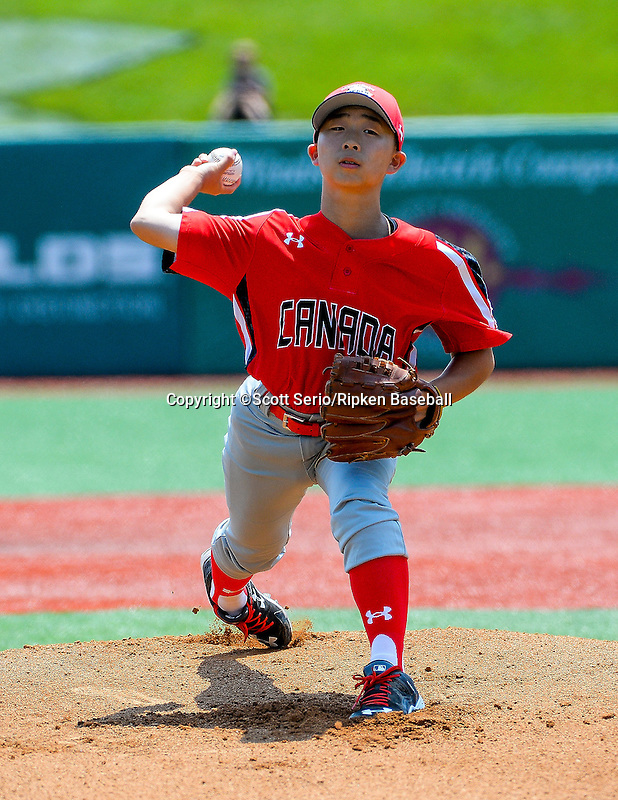 July 26, 2015: Yudai Tanaka (11) of Canada pitches against Dominican Republic in the game between the Dominican Republic and Canada during the Cal Ripken World Series at the Ripken Experience powered by Under Armour in Aberdeen, Maryland. Scott Serio/Ripken Baseball/CSM