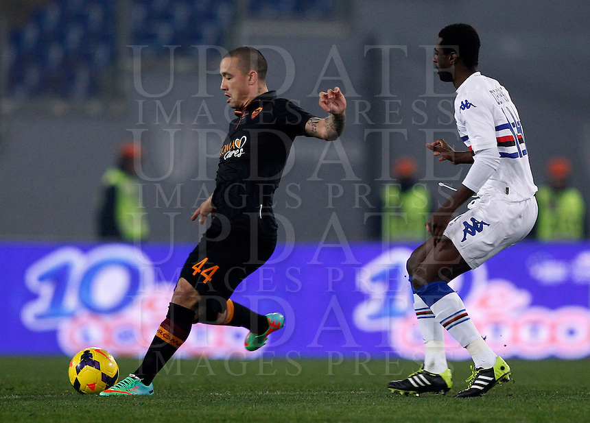 Calcio, ottavi di finale di Coppa Italia Tim: Roma vs Sampdoria. Roma, stadio Olimpico, 9 gennaio 2014.<br /> AS Roma midfielder Radja Nainggolan, of Belgium, is chased by Sampdoria midfielder Pedro Obiang, of Spain, during the Italy Cup round of sixteen football match between AS Roma and Sampdoria at Rome's Olympic stadium, 9 January 2014.<br /> UPDATE IMAGES PRESS/Isabella Bonotto