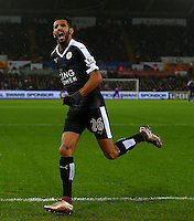 Riyad Mahrez of Leicester City celebrates scoring his goal to make the score 0-3 and complete his hattrick during the Barclays Premier League match between Swansea City and Leicester City played at The Liberty Stadium on 5th December 2015