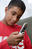 Teenager holding a mobile phone,