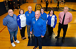 WATERBURY,  CT-011520JS11- Crosby High School boys basketball coach Nick Augelli is nearing 700 career wins. He is surrounded by staff and boosters, from left, former statistician Joe White; booster club member Debi Vassar; assistant coach Bill Mahony; Cathy Awad; booster club member Irma Sackett and assistant coach Larry Devito. <br /> Jim Shannon Republican-American