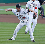 Reno Aces starting pitcher Charles Brewer makes the play on a bunt agianst the Albuquerque Isotopes during their game on Friday night August 10, 2012 at Aces Ballpark in Reno NV.