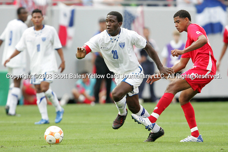 11 March 2008: Hendry Thomas (HON) (20) dribbles past a Panama defender. The Honduras U-23 Men's National Team defeated the Panama U-23 Men's National Team 1-0 at Raymond James Stadium in Tampa, FL in a Group A game during the 2008 CONCACAF's Men's Olympic Qualifying Tournament.