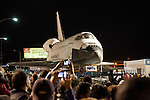 Inglewood, Los Angeles, CA, USA- 12 October, 2012 - The Space Shuttle Endeavour is towed through the streets of Los Angeles on its way to its permanent home at the California Science Center, making a nighttime stop at La Cienega and Manchester Blvd where a Toyota Tundra truck will replace the heavier transport to tow it across the bridge over the 405 Freeway. The Shuttle was decommissioned in 2011 when the NASA space program was discontinued.