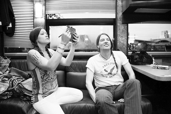 Zia McCabe applies her make-up while Courtney Taylor-Taylor looks on inside The Dandy Warhols tour bus before their show at the Mercy Lounge in Nashville, Tennessee on May 5th, 2014.