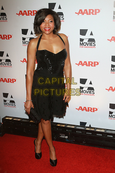 TARAJI P. HENSON.AARP The Magazine's 10th Annual Movies For Grownups Awards held At The Beverly Wilshire Hotel, Hollywood, California, USA..February 7th, 2011.full length black dress halterneck clutch bag.CAP/ADM/KB.©Kevan Brooks/AdMedia/Capital Pictures.