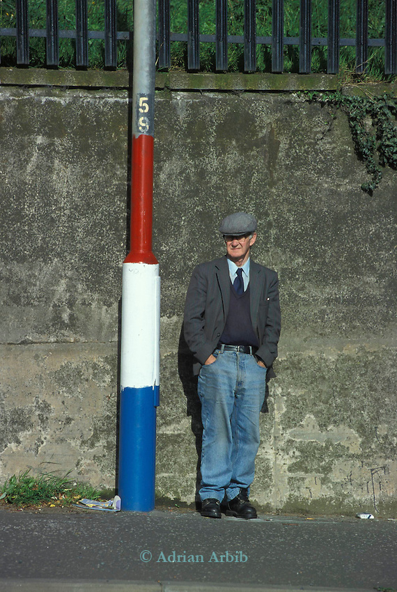 lamp posts are painted in the colours of the Union Jack flag; painted by the Protestant community in Belfast, Northern Ireland.