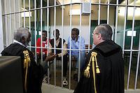 Gli avvocati Douglas Duale, sinistra, e Massimo Mercurelli, destra, parlano ai presunti pirati somali, da sinistra, Mohamed Isse Karshe, Abdi Hassan Mahamur ed Ahmed Malimed Ali, accusati dell'attacco alla nave portacontainer italiana Montecristo, durante la prima udienza del processo presso la III Corte d'Assise a Roma, 23 marzo 2012. La nave, assaltata il 10 ottobre 2011 al largo della Somalia, venne liberata il 15 ottobre dai Royal Marines britannici con l'ausilio di una nave militare statunitense..Lawyers Douglas Duale, left, and Massimo Mercurelli, right, talk to Somali allegedly pirates, from left, Mohamed Isse Karshe, Abdi Hassan Mahamur and Ahmed Malimed Ali, during the opening audience for the assault to the Montecristo container ship, in Rome, 23 march 2012. The ship was attacked on 10 october 2011 and freed by US navy and British Royal Marines on 15 october..UPDATE IMAGES PRESS/Riccardo De Luca