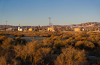 730850357 oil derricks and storage tanks in a working oil field in southern kern county california