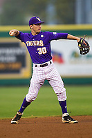 LSU Tigers shortstop Alex Bregman #30 makes a throw to first base against the Auburn Tigers in the NCAA baseball game on March 23, 2013 at Alex Box Stadium in Baton Rouge, Louisiana. LSU defeated Auburn 5-1. (Andrew Woolley/Four Seam Images).