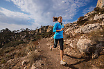 Woman trail running along the Mediterranean coast.