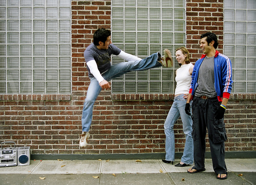 Young man jumps in the air entertaining friends. MR